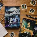 Win an Autographed Copy of Serafina and the Seven Stars